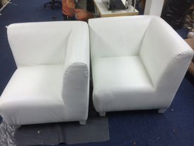 A pair of re-upholstered corner seats