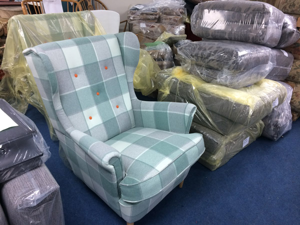 A re-upholstered wing chair in a stylish check fabric