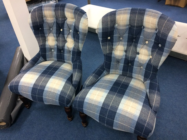 The set of repholstered armchairs in a modern check fabric