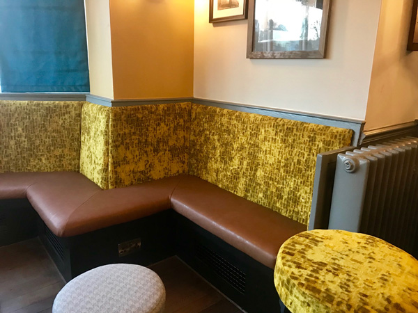 A newly re-upholstered pub bar seating area