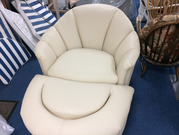 The tub chair has been re-upholstered in a contemporary leather