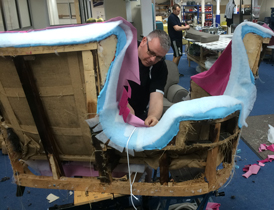 An in-house upholsterer at work