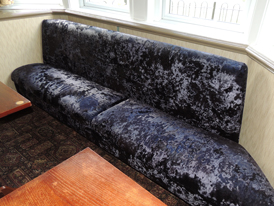 Re-upholstered window seat for a pub