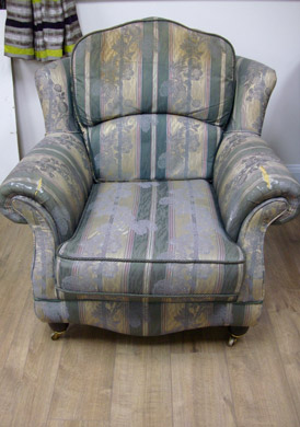 A re-upholstered armchair