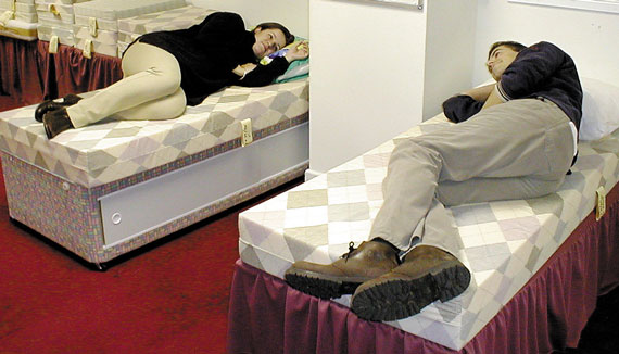 Customers try out two of our many foam mattress options