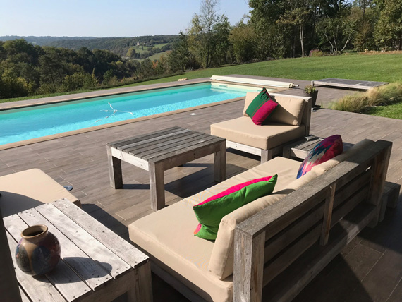 A transformed poolside seating area with our outdoor cushions