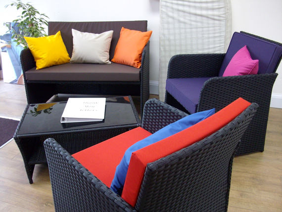 Many outdoor cushion examples on display in our Bristol Showroom