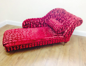 A re-upholstered chaise longue